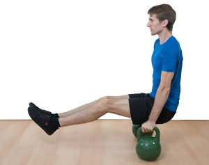 L-Sit on two kettlebells